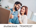 man using laptop and woman... | Shutterstock . vector #793459237