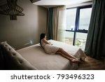 sexy girl in a light dress lies ... | Shutterstock . vector #793496323