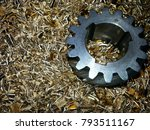 Small photo of Old right handed involute helical gear on bronze cuttings as background
