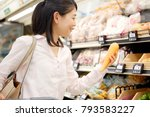 asian woman in the grocery store | Shutterstock . vector #793583227