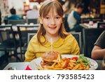 happy kid girl eating hamburger ... | Shutterstock . vector #793585423