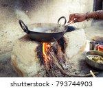 woman cooking food in...   Shutterstock . vector #793744903