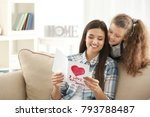 young woman with greeting card... | Shutterstock . vector #793788487