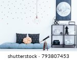 telescope next to blue mattress ... | Shutterstock . vector #793807453