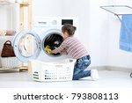 cute little girl doing laundry... | Shutterstock . vector #793808113