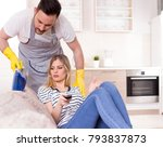 young man with apron vacuuming... | Shutterstock . vector #793837873