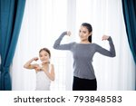 mother and daughter showing... | Shutterstock . vector #793848583