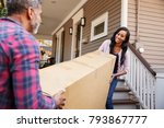 couple carrying big box... | Shutterstock . vector #793867777