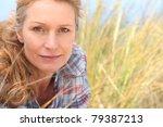 woman in long grass | Shutterstock . vector #79387213