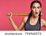 surprised woman with a bat on ... | Shutterstock . vector #793960573