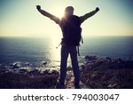 successful female hiker hiking... | Shutterstock . vector #794003047