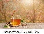 honey bee in glass jar with... | Shutterstock . vector #794013547