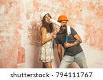 builder man and girl in helmet... | Shutterstock . vector #794111767