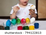 Toddler Boy Color Easter Eggs...