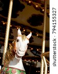 white painted carousel horse in ... | Shutterstock . vector #794155327