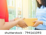 woman receiving package from... | Shutterstock . vector #794161093