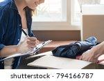 happy woman checking stuff in...   Shutterstock . vector #794166787