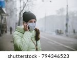 a woman stands near a road in... | Shutterstock . vector #794346523