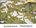 Small photo of Toy Alligators in a Pile Crocodiles Plastic Alligator Background Green