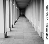 Small photo of Black and white corridor archway perspective. Square proportion.