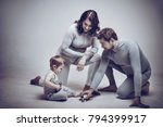 parents and child in the studio ... | Shutterstock . vector #794399917
