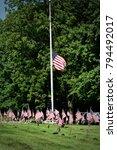 flag at half mast in cemetery... | Shutterstock . vector #794492017