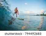 surfer rides the wave during... | Shutterstock . vector #794492683