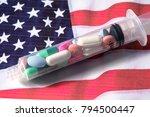 various pills inside syringe on ... | Shutterstock . vector #794500447
