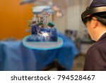 Small photo of Smart medical technology robot concept, Doctor(blurred) use augmented mixed virtual reality technology in operation room to see the autonomous robotic x-ray the patient to analysis,diagnose in 3d