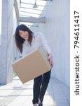 japanese businesswoman dropping ... | Shutterstock . vector #794611417