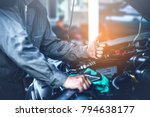 technician working on checking... | Shutterstock . vector #794638177