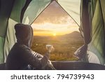 Young Woman Traveler Sitting I...