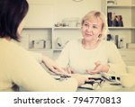 Small photo of Mature woman consults with a financial adviser for the proper conduct of home accounting