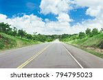 road crossing the forest with... | Shutterstock . vector #794795023