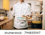 male chef hold sushi rolls on... | Shutterstock . vector #794835547