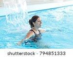 woman relaxing in a swimming... | Shutterstock . vector #794851333
