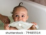 Cute baby boy bathing - stock photo