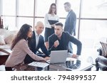 young team of coworkers making... | Shutterstock . vector #794899537