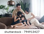 happy asian family using the... | Shutterstock . vector #794913427