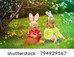 happy kids on easter eggs hunt... | Shutterstock . vector #794929567
