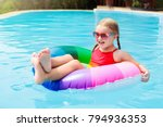child with goggles in swimming... | Shutterstock . vector #794936353