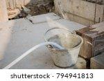 refilling water to the bucket... | Shutterstock . vector #794941813