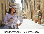 attractive woman tourist with... | Shutterstock . vector #794960557