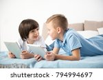 two kids discussing new game... | Shutterstock . vector #794994697