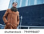 low angle portrait of glad man... | Shutterstock . vector #794998687