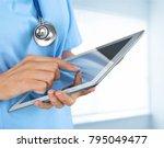 woman doctor using tablet...   Shutterstock . vector #795049477
