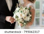 the bride holding wedding... | Shutterstock . vector #795062317