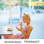 blond woman talking on the... | Shutterstock . vector #795096457