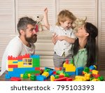 mom holds son near toy... | Shutterstock . vector #795103393