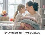 winter portrait of happy loving ...   Shutterstock . vector #795108607